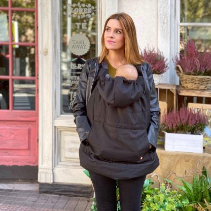 mother wearing an All Weather Baby Cover for babywearing